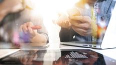 Business team meeting present. Photo professional investor working with new startup project. Finance managers task.Digital tablet laptop computer design smart phone using. Blurred background, Sun flare effect,Horizontal